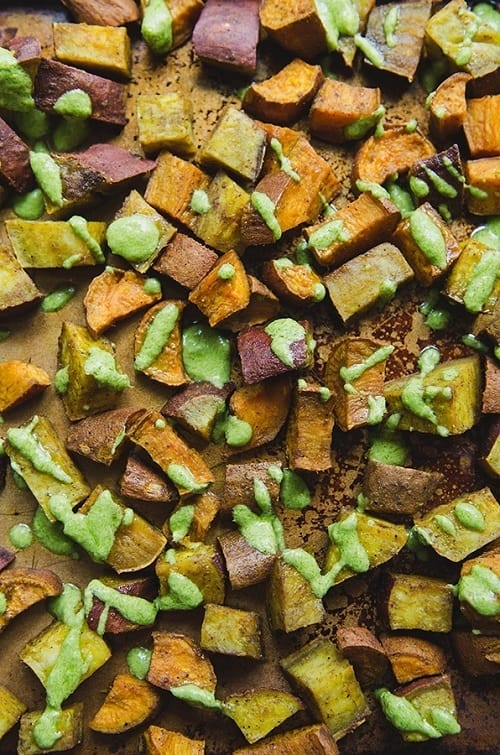 Turmeric Roasted Sweet Potatoes With Parsley Tahini Sauce